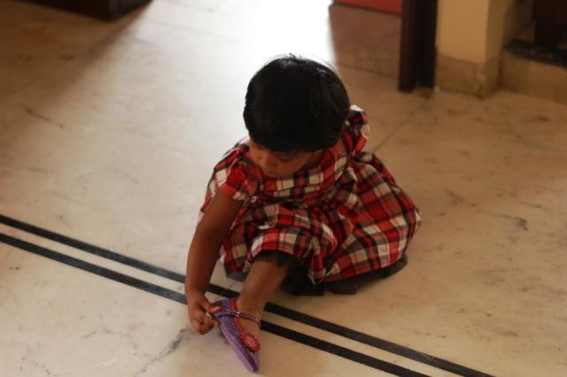 Aanya admiring her Dora shoes