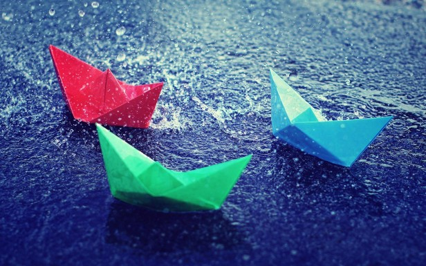 paper boats in puddles