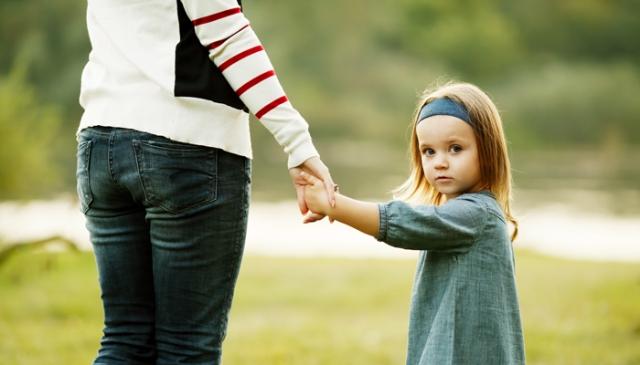 motherholdingdaughterhands